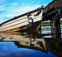 In reflection by Doug McRae