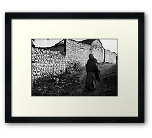 Woman Walking Against a White Wall Framed Print