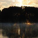 Sun fire, fog and lake by Antanas
