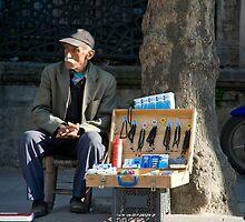 Trinket Salesman by phil decocco