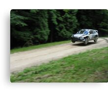 Jumping rally car at the Goodwood Festival of Speed Canvas Print