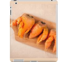 raw deformed carrot roots iPad Case/Skin