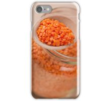 Portion of red lentils on wooden spoon iPhone Case/Skin