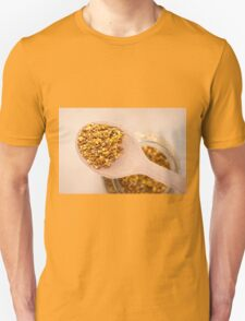 pollen grains portion on wooden spoon Unisex T-Shirt