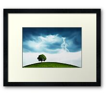 Storm and tree Framed Print