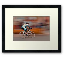 A Lone Cyclist Heads into the Final Lap Framed Print