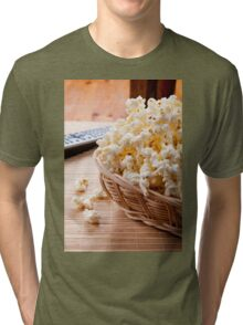basket full of many crunchy popcorn Tri-blend T-Shirt