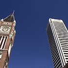 Modern and old, both touching the sky by Tricia Holmes