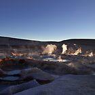 Sunrise at he boiling mud pools at the Sol de Manana Geyser, Atacama, Altiplano, Sud Lipez, Chile border, Bolivia, South america by Thibaut PETIT-BARA