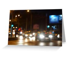 Abstract blurred image of a night scene with bright lights Greeting Card