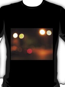 Abstract blur image of round spots of bright multicolored lights T-Shirt
