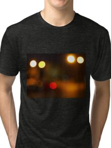 Abstract blur image of round spots of bright multicolored lights Tri-blend T-Shirt