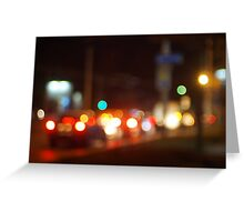 Abstract blur image of a night scene with bright lights Greeting Card
