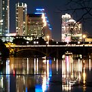 Reflections of Austin Skyline in Lady Bird Lake at night by Jeff Kauffman