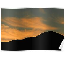 Wisps of Clouds Over a Mountain Poster