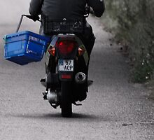 Man, pannier, motorcycle and road by Antanas