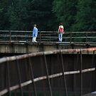 A Stroll Across The Iron Bridge by Geno Rugh