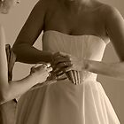 Bride Putting on Bracelets on Wedding Day by thebaum