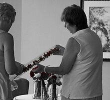 Mother of the Bride and Groom Admire the Boutonnière by thebaum