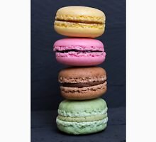 Colorful macarons on a black wood T-Shirt