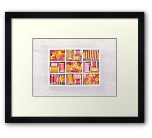Collection of yellow, red, pink spools  threads  arranged in a white wooden box Framed Print
