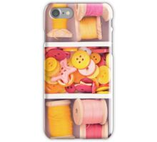 Collection of yellow, red, pink spools  threads  arranged in a white wooden box iPhone Case/Skin