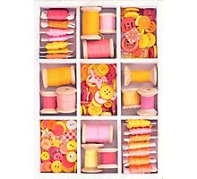 Collection of yellow, red, pink spools  threads on in a white wooden box Photographic Print