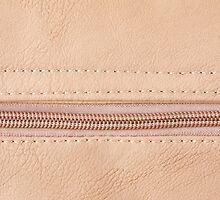 Beige zipper on leather cloth texture by Arletta Cwalina