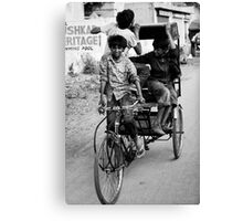 Boys playing on rickshaw  Canvas Print
