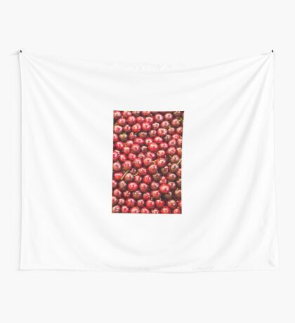 Many cherries on a market stall Wall Tapestry
