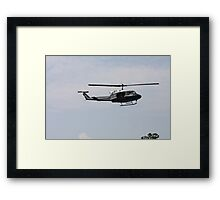 Helicopter Hovering Over The River Framed Print