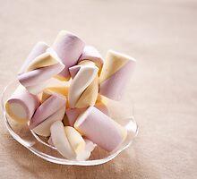 Puffy marshmallows twists on plate by Arletta Cwalina