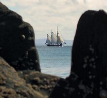 Sailing ship between the rocks by Conor Donaghy