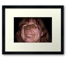 Something is on my nose Framed Print