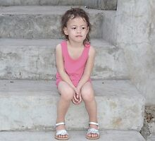 2 year old girl on stark concrete stairs by Dave P