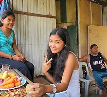 Teenage girls making dinner Gibitngil Island, Cebu, Philippines. by Dave P