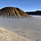 Gunung Bromo valley in fog by Milonk