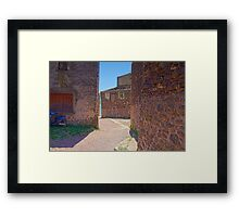 Red Ghost Village with blue Scooter Framed Print