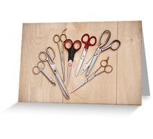 scissors bunch lying on board Greeting Card