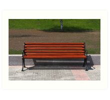 new wooden bench in a city park Art Print