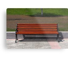 new wooden bench in a city park Metal Print
