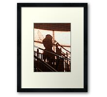 Who is that coming down the stairs? Framed Print