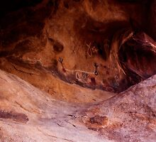 Petroglyphs and the Arch by Justin Mair