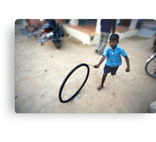 Boy playing with tyre Metal Print