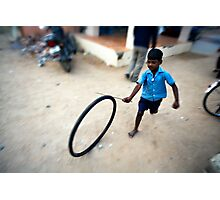 Boy playing with tyre Photographic Print