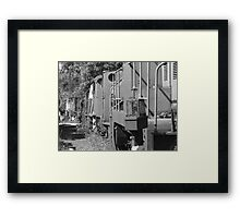 Old boilers in a line Framed Print