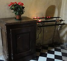 Flowers and candles in ancient church - Vence, France by tracyannjones
