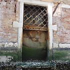 Old water door on canal - Venice, Italy by tracyannjones