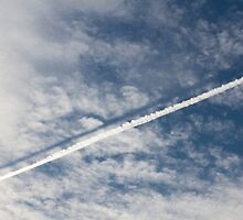 wake of the plane in the clouds by spetenfia