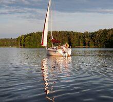 white boat sailing view  by Arletta Cwalina